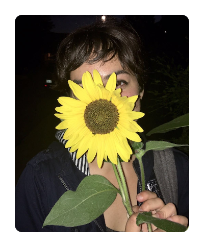 Photo of Kiki with a sunflower